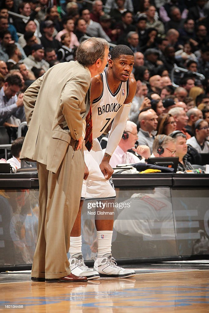 Joe Johnson #7 of the Brooklyn Nets speaks with P.J. Carlesimo during the game against the Denver Nuggets on February 13, 2013 at the Barclays Center in the Brooklyn borough of New York City in New York City.