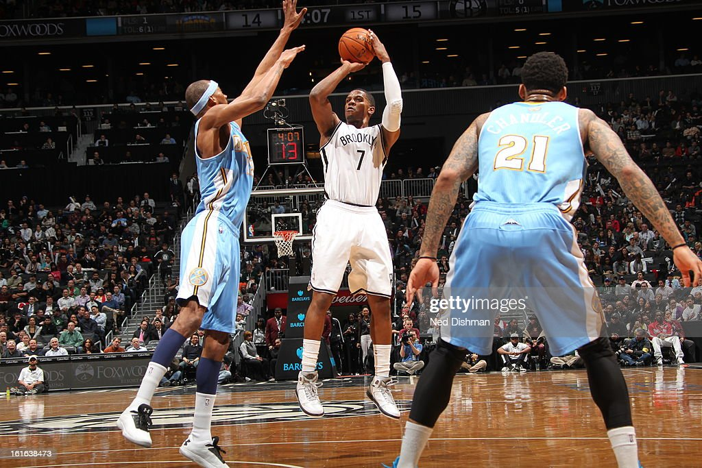 Joe Johnson #7 of the Brooklyn Nets takes a shot against the Denver Nuggets at the Barclays Center on February 13, 2013 in the Brooklyn borough of New York City in New York City.