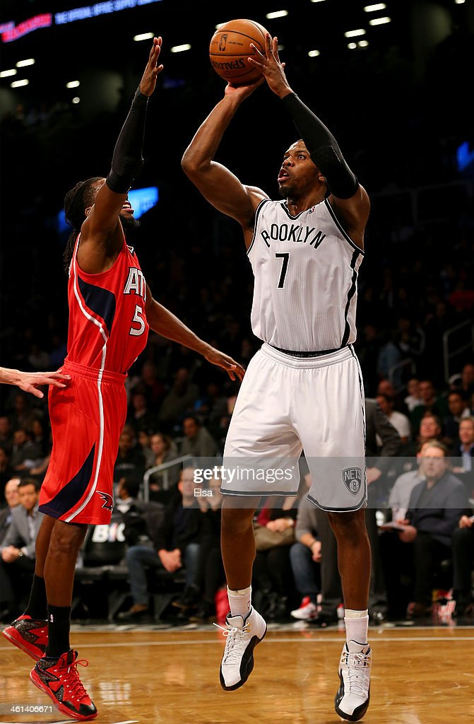 Joe Johnson #7 of the Brooklyn Nets takes a shot as <a gi-track='captionPersonalityLinkClicked' href=/galleries/search?phrase=DeMarre+Carroll&family=editorial&specificpeople=784686 ng-click='$event.stopPropagation()'>DeMarre Carroll</a> #5 of the Atlanta Hawks defends at the Barclays Center on January 6, 2014 in the Brooklyn borough of New York City.The Brooklyn Nets defeated the Atlanta Hawks 91-86.