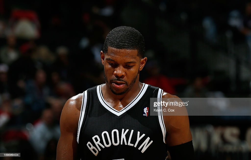 Joe Johnson #7 of the Brooklyn Nets walks to the bench in the final minutes against the Atlanta Hawks at Philips Arena on January 16, 2013 in Atlanta, Georgia.