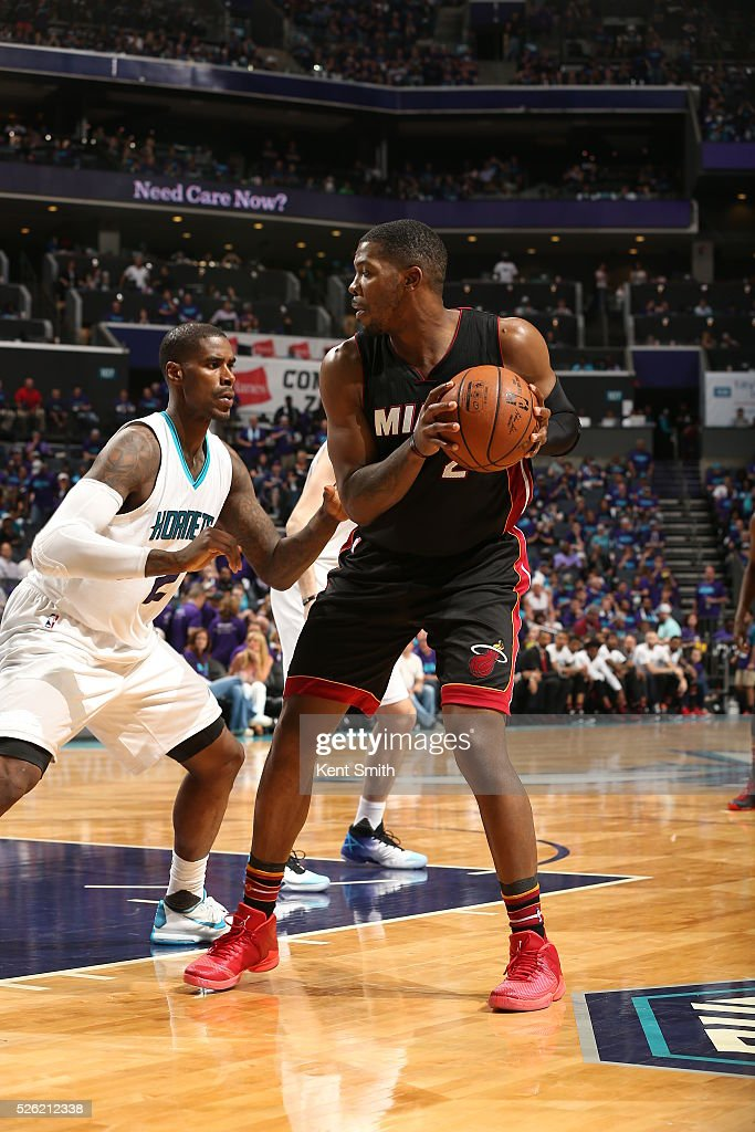 <a gi-track='captionPersonalityLinkClicked' href=/galleries/search?phrase=Joe+Johnson+-+Basketball+Player&family=editorial&specificpeople=201652 ng-click='$event.stopPropagation()'>Joe Johnson</a> #2 of the Miami Heat handles the ball against <a gi-track='captionPersonalityLinkClicked' href=/galleries/search?phrase=Marvin+Williams&family=editorial&specificpeople=206784 ng-click='$event.stopPropagation()'>Marvin Williams</a> #2 of the Charlotte Hornets in Game Six of the Eastern Conference Quarterfinals during the 2016 NBA Playoffs on April 29, 2016 at Time Warner Cable Arena in Charlotte, North Carolina.