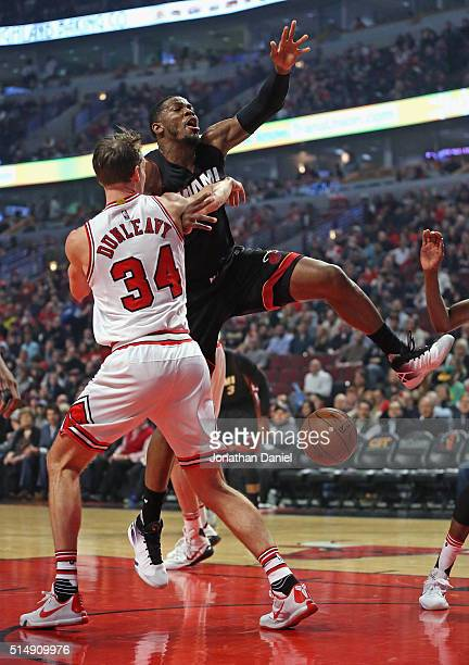 Joe Johnson of the Miami Heat looses control of the ball after being fouled by Mike Dunleavy of the Chicago Bulls at the United Center on March 11...