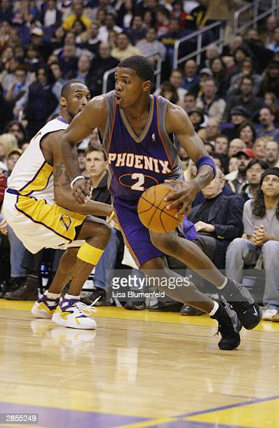 Joe Johnson of the Phoenix Suns drives to the basket past Kobe Bryant of the Los Angeles Lakers on December 21 2003 at Staples Center in Los Angeles...