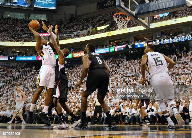 Joe Johnson of the Utah Jazz goes up for a shot over Jamal Crawford of the Los Angeles Clippers in the first half in Game Four of the Western...