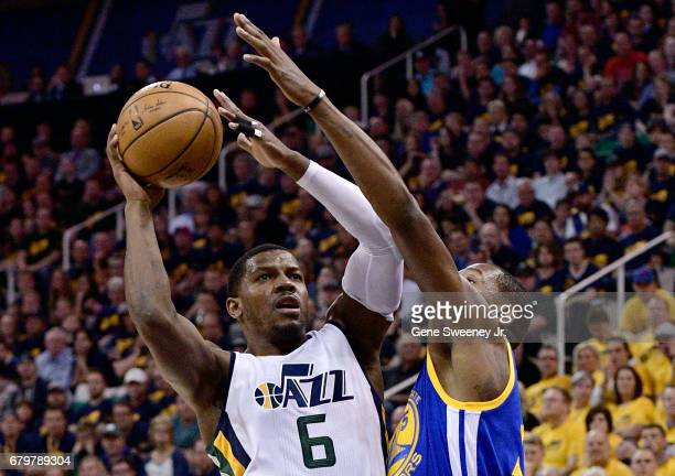 Joe Johnson of the Utah Jazz tries for the basket past the defense of Kevin Durant of the Golden State Warriors in the first half in Game Three of...