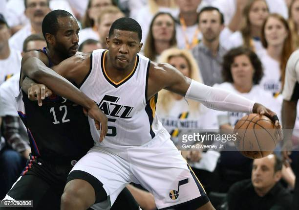 Joe Johnson of the Utah Jazz tries to drive past the defense of Luc Mbah a Moute of the Los Angeles Clippers in the second half of the 10598 win by...