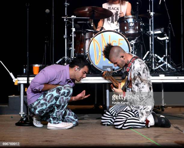 Joe Jonas and Cole Whittle of DNCE perform on stage during the 2017 BLI Summer Jam at Nikon at Jones Beach Theater on June 16 2017 in Wantagh New York