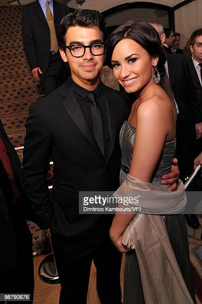 Joe Jonas and Demi Lovato attend the Bloomberg/Vanity Fair party following the 2010 White House Correspondents' Association Dinner at the residence...