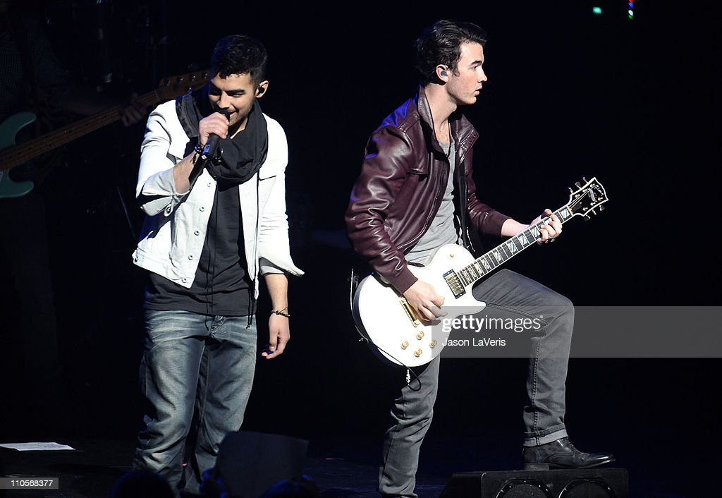 Joe Jonas and Kevin Jonas of The Jonas Brothers perform at the 2011 Concert For Hope at Gibson Amphitheatre on March 20, 2011 in Universal City, California.