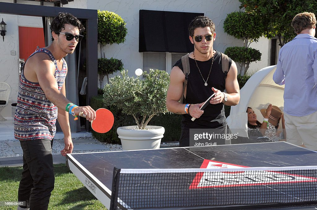 <a gi-track='captionPersonalityLinkClicked' href=/galleries/search?phrase=Joe+Jonas&family=editorial&specificpeople=842712 ng-click='$event.stopPropagation()'>Joe Jonas</a> and <a gi-track='captionPersonalityLinkClicked' href=/galleries/search?phrase=Nick+Jonas&family=editorial&specificpeople=842713 ng-click='$event.stopPropagation()'>Nick Jonas</a> attend the GUESS Hotel pool party at the Viceroy Palm Springs on April 14, 2013 in Palm Springs, California.