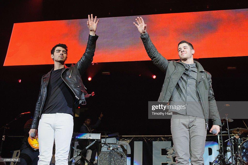 Joe Jonas and Nick Jonas perform during the B96 Pepsi Jingle Bash at Allstate Arena on December 14, 2013 in Chicago, Illinois.