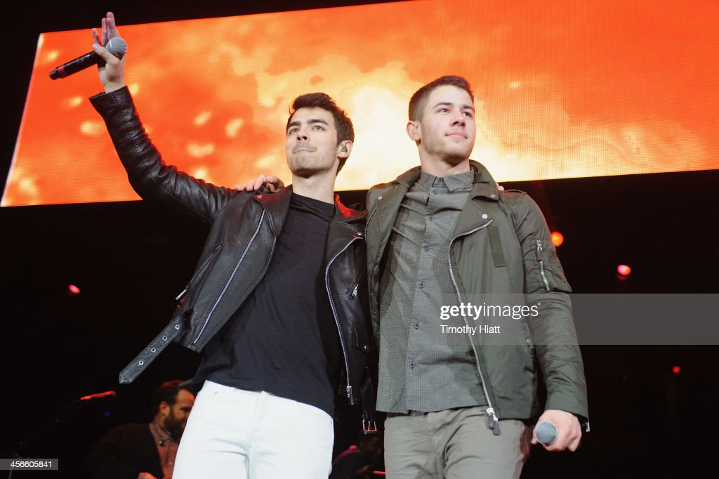 Joe Jonas and Nick Jonas perform during the B96 Pepsi Jingle Bash at Allstate Arena on December 14, 2013 in Chicago, Illinois.