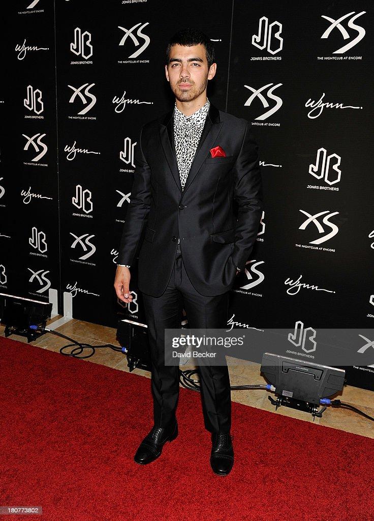 Joe Jonas arrives at XS The Nightclub at Encore Las Vegas to celebrates his brother, Nick's, 21st birthday on September 16, 2013 in Las Vegas, Nevada.