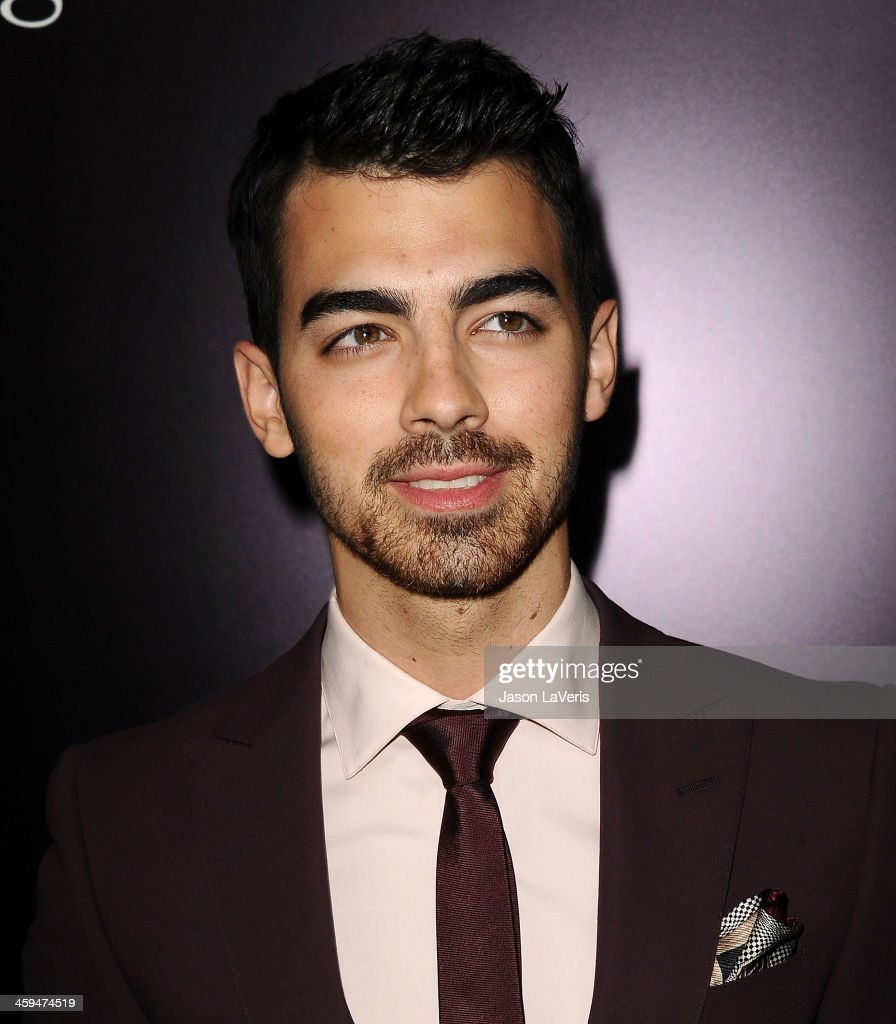 <a gi-track='captionPersonalityLinkClicked' href=/galleries/search?phrase=Joe+Jonas&family=editorial&specificpeople=842712 ng-click='$event.stopPropagation()'>Joe Jonas</a> attends the Ermenegildo Zegna Boutique grand opening on November 7, 2013 in Beverly Hills, California.