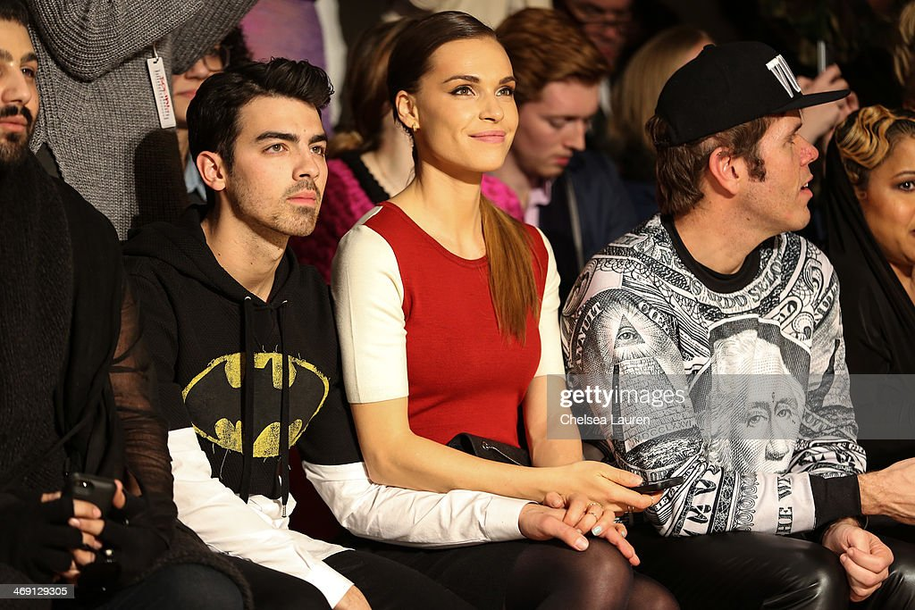 <a gi-track='captionPersonalityLinkClicked' href=/galleries/search?phrase=Joe+Jonas&family=editorial&specificpeople=842712 ng-click='$event.stopPropagation()'>Joe Jonas</a>, <a gi-track='captionPersonalityLinkClicked' href=/galleries/search?phrase=Blanda+Eggenschwiler&family=editorial&specificpeople=7937749 ng-click='$event.stopPropagation()'>Blanda Eggenschwiler</a> and <a gi-track='captionPersonalityLinkClicked' href=/galleries/search?phrase=Perez+Hilton&family=editorial&specificpeople=598309 ng-click='$event.stopPropagation()'>Perez Hilton</a> attend the The Blonds fashion show during MADE Fashion Week Fall 2014 at Milk Studios on February 12, 2014 in New York City.