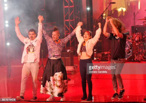 Joe Jonas Cole Whittle JinJoo Lee and Jack Lawless of DNCE perform onstage at the Westfield Century City Reopening Celebration on October 3 2017 in...
