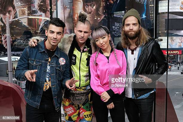 Joe Jonas Cole Whittle JinJoo Lee and Jack Lawless of DNCE visit 'Extra' at their New York studios at HM in Times Square on November 16 2016 in New...