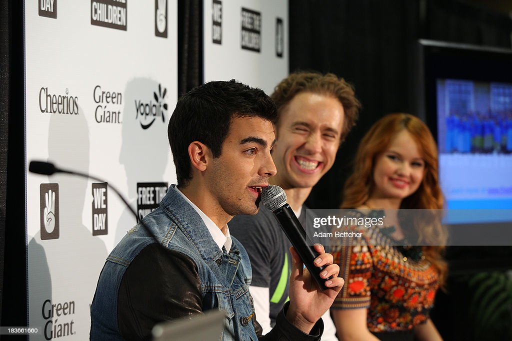 Joe Jonas, Craig Kielburger and Debby Ryan answer questions from the media during a press conference at the We Day Minnesota event at the Xcel Energy Center in St. Paul, Minnesota on October 8, 2013 (Photo by Adam Bettcher/Getty Images for Free the Children) *** Local Caption Joe Jonas; Craig Kielburger; Debby Ryan