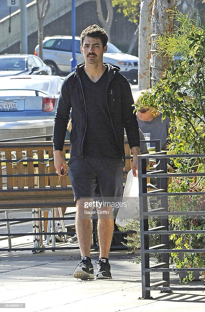 <a gi-track='captionPersonalityLinkClicked' href=/galleries/search?phrase=Joe+Jonas&family=editorial&specificpeople=842712 ng-click='$event.stopPropagation()'>Joe Jonas</a> is seen picking up lunch in West Hollywood on December 09, 2013 in Los Angeles, California.