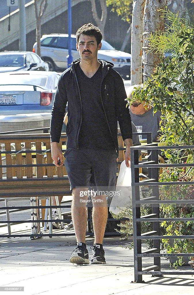 Joe Jonas is seen picking up lunch in West Hollywood on December 09, 2013 in Los Angeles, California.