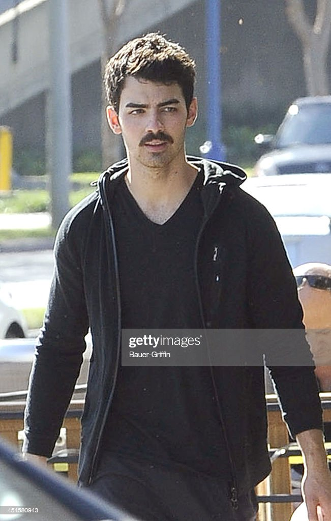 Joe Jonas is seen picking up lunch in West Hollywood on December 09, 2013 in Los Angeles, California.