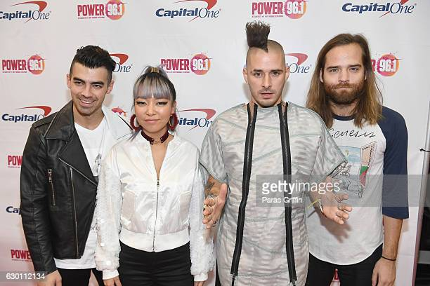 Joe Jonas JinJoo Lee Cole Whittle and Jack Lawless of DNCE attend Power 961's Jingle Ball 2016 at Philips Arena on December 16 2016 in Atlanta Georgia