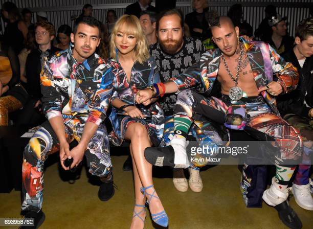 Joe Jonas JinJoo Lee Jack Lawless and Cole Whittle of DNCE attend Moschino Spring/Summer 18 Menswear and Women's Resort Collection at Milk Studios on...
