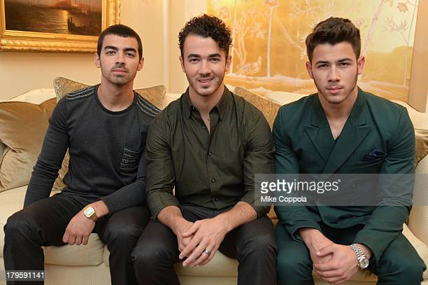 Joe Jonas Kevin Jonas and Nick Jonas of the Jonas Brothers attend the MercedesBenz Star Lounge during MercedesBenz Fashion Week Spring 2014 at...