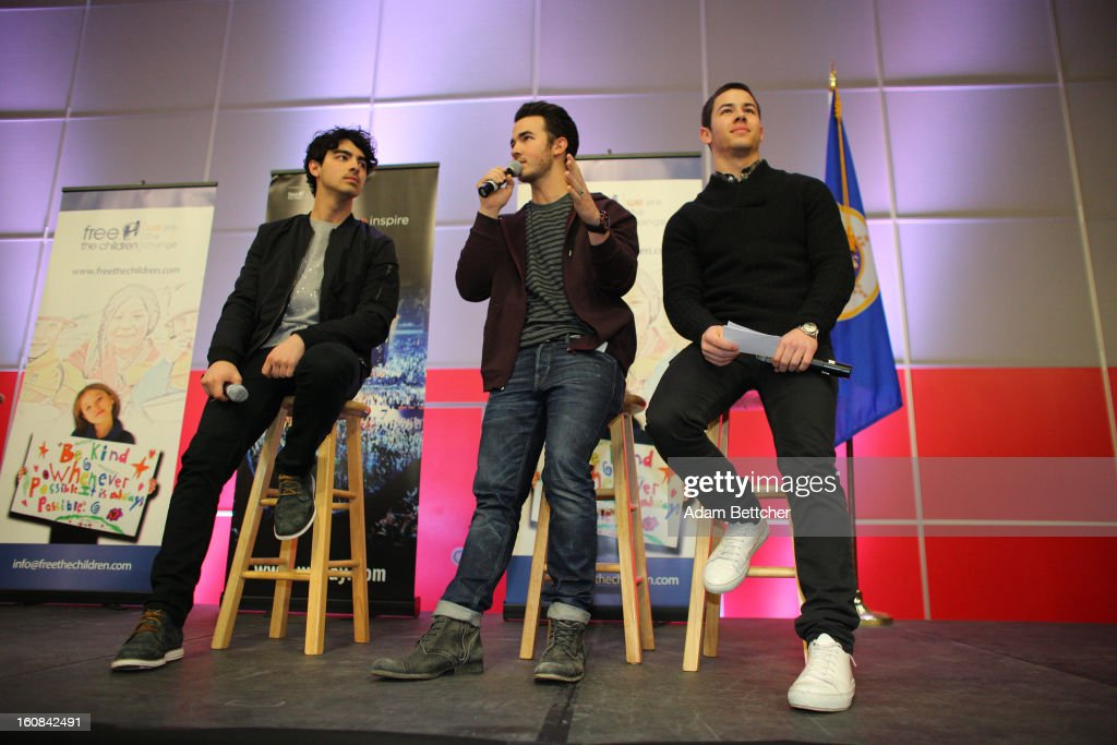 <a gi-track='captionPersonalityLinkClicked' href=/galleries/search?phrase=Joe+Jonas&family=editorial&specificpeople=842712 ng-click='$event.stopPropagation()'>Joe Jonas</a>, <a gi-track='captionPersonalityLinkClicked' href=/galleries/search?phrase=Kevin+Jonas&family=editorial&specificpeople=709547 ng-click='$event.stopPropagation()'>Kevin Jonas</a> and <a gi-track='captionPersonalityLinkClicked' href=/galleries/search?phrase=Nick+Jonas&family=editorial&specificpeople=842713 ng-click='$event.stopPropagation()'>Nick Jonas</a> of the musical trio the Jonas Brothers surprise 600 students at Minneapolis Patrick Henry High School to launch 'We Day' on February 6, 2013 in Minneapolis, Minnesota.
