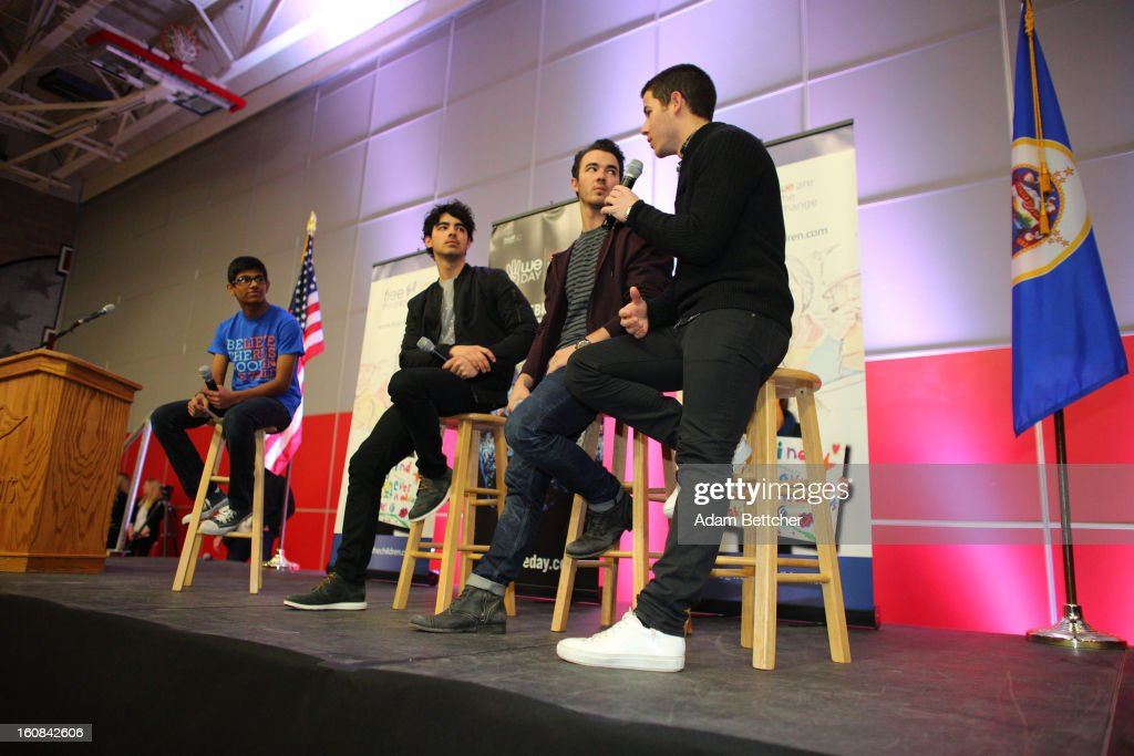 Joe Jonas, Kevin Jonas and Nick Jonas of the musical trio the Jonas Brothers answer questions from student Siddartha Paari after surprising 600 students at Minneapolis Patrick Henry High School to launch 'We Day' on February 6, 2013 in Minneapolis, Minnesota.