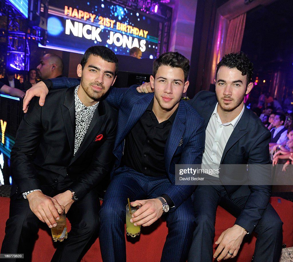Joe Jonas, Nick Jonas and Kevin Jonas celebrate Nick Jonas's 21st birthday at XS The Nightclub at Encore Las Vegas on September 16, 2013 in Las Vegas, Nevada.