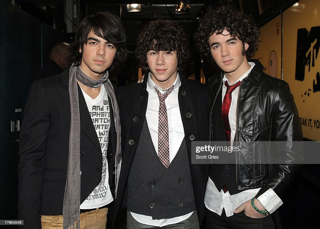 Joe Jonas Nick Jonas and Kevin Jonas of the band The Jonas Brothers pose for a photo backstage during MTV's Total Request Live at the MTV Times...