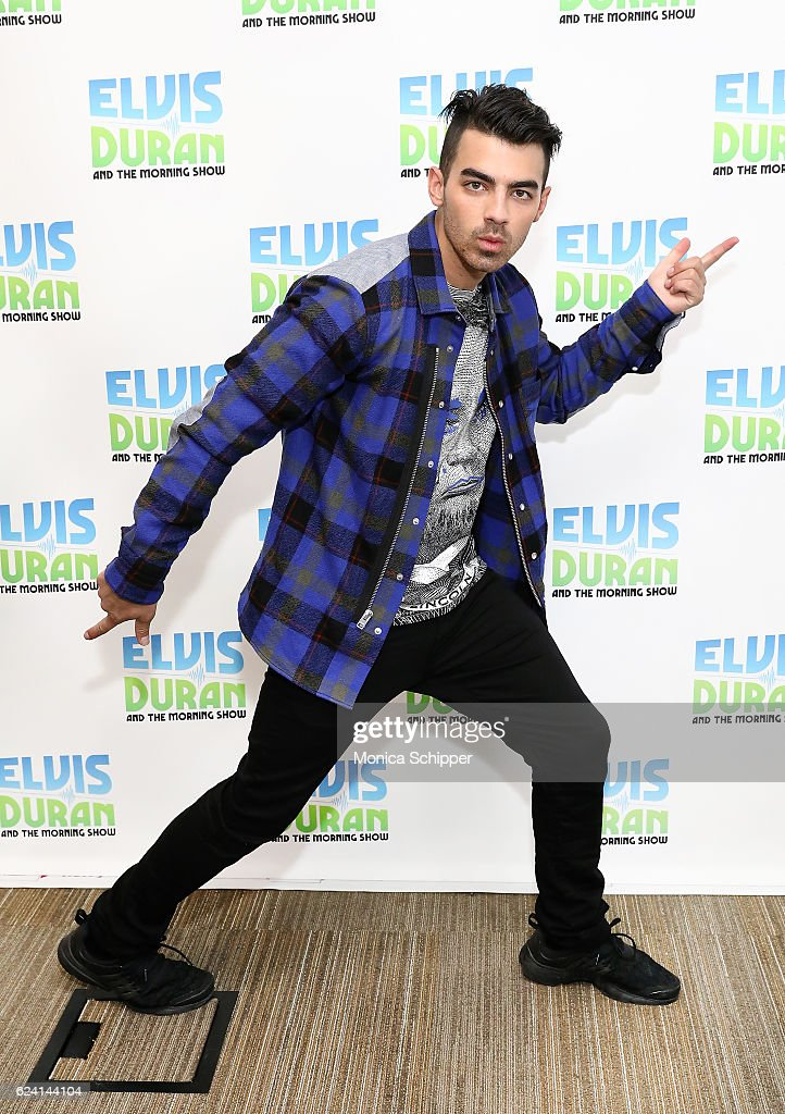 Joe Jonas of band DNCE poses for a photo when DNCE visit 'The Elvis Duran Z100 Morning Show' at Z100 Studio on November 18, 2016 in New York City.