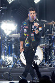 Joe Jonas of DNCE performs during the Revival Tour at The Palace of Auburn Hills on June 25 2016 in Auburn Hills Michigan