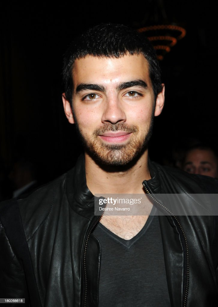 Joe Jonas of Jonas Brothers attends the Diesel Black Gold show during Spring 2014 MercedesBenz Fashion Week at Vanderbilt Hall at Grand Central...