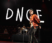 Joe Jonas of the band DNCE performs onstage during Power 961's Jingle Ball 2015 at Philips Arena on December 17 2015 in Atlanta Georgia