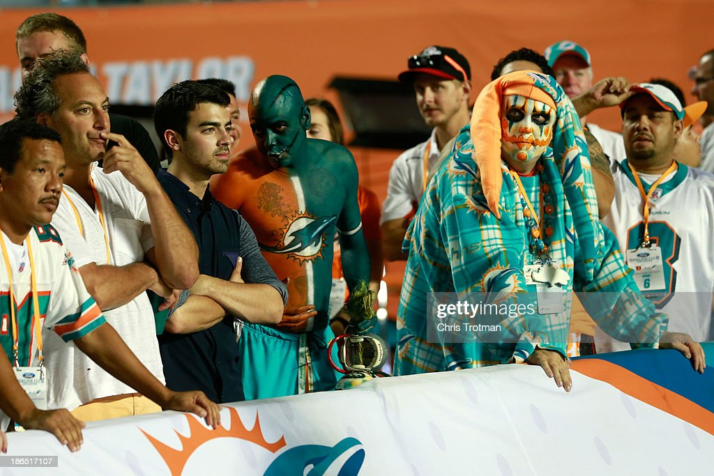 Joe Jonas of the Jonas Brothers attends an NFL game between the Miami Dolphins and the Cincinnati Bengals at Sun Life Stadium on October 31, 2013 in Miami Gardens, Florida.