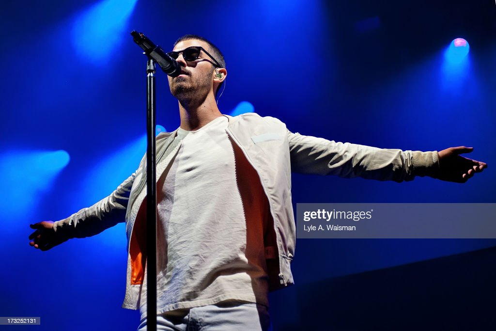 <a gi-track='captionPersonalityLinkClicked' href=/galleries/search?phrase=Joe+Jonas&family=editorial&specificpeople=842712 ng-click='$event.stopPropagation()'>Joe Jonas</a> performs during the opening night of the Jonas Brothers Live Tour 2013 at FirstMerit Bank Pavilion at Northerly Island on July 10, 2013 in Chicago, Illinois.