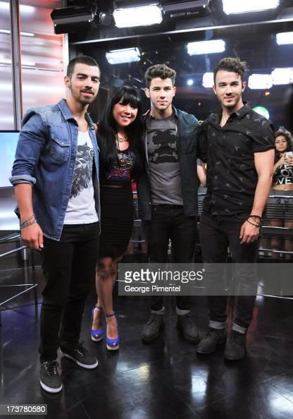 Joe JonasNick Jonas andKevin Jonas of the Jonas Brothersand Host Lauren Toyota Live at Much at MuchMusic Headquarters on July 17 2013 in Toronto...