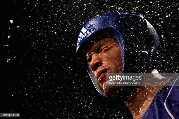 Joe Joyce of England is sprayed with water in his corner during his fight against Ross Henderson of Scotland in their 91kg fight during the Great...