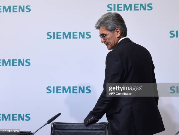 Joe Kaeser CEO of German industrial conglomerate Siemens leaves at the end of the annual results press conference on Nvember 9 2017 in Munich...