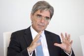 Joe Kaeser chief executive officer of Siemens AG gestures as he speaks during an interview in Frankfurt Germany on Wednesday July 2 2014 Siemens AG...