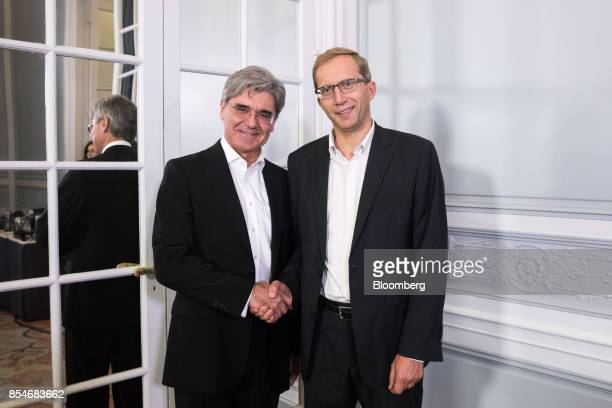 Joe Kaeser chief executive officer of Siemens AG left and Henri PoupartLafarge chief executive officer of Alstom SA pose for a photograph following...