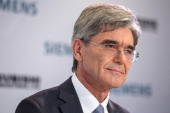 Joe Kaeser chief executive officer of Siemens AG pauses during a news conference to announce a joint bid with Mitsubishi Heavy Industries Ltd for...