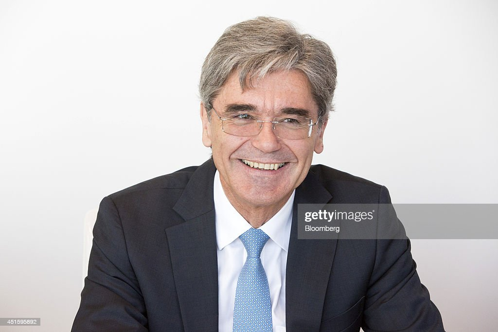 <a gi-track='captionPersonalityLinkClicked' href=/galleries/search?phrase=Joe+Kaeser&family=editorial&specificpeople=558326 ng-click='$event.stopPropagation()'>Joe Kaeser</a>, chief executive officer of Siemens AG, reacts as he speaks during an interview in Frankfurt, Germany, on Wednesday, July 2, 2014. Siemens AG, Europe's largest engineering company, plans to focus on electrification, digitalization and automation. Photographer: Martin Leissl/Bloomberg via Getty Images