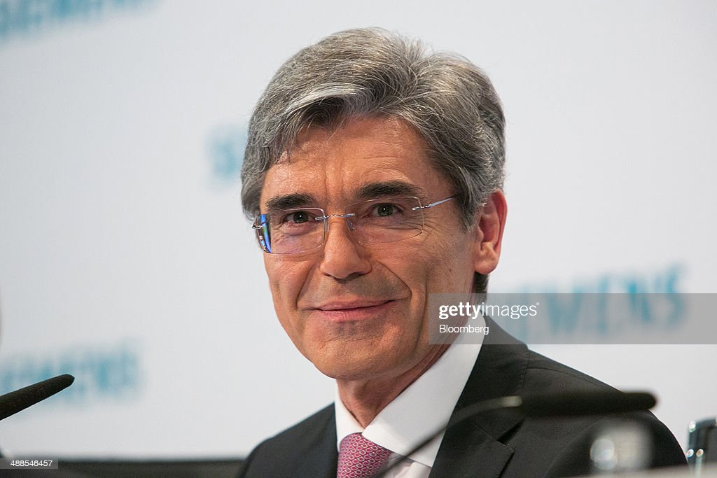 <a gi-track='captionPersonalityLinkClicked' href=/galleries/search?phrase=Joe+Kaeser&family=editorial&specificpeople=558326 ng-click='$event.stopPropagation()'>Joe Kaeser</a>, chief executive officer of Siemens AG, reacts during a news conference as the company announce their second-quarter results during a news conference in Berlin, Germany, on Wednesday, May 7, 2014. Kaeser is overhauling the 167-year old company's 60 units that make everything from trains to medical scanners to strengthen profitable energy and industry automation businesses. Photographer: Krisztian Bocsi/Bloomberg via Getty Images