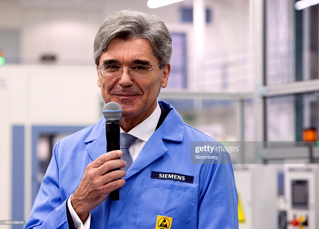 <a gi-track='captionPersonalityLinkClicked' href=/galleries/search?phrase=Joe+Kaeser&family=editorial&specificpeople=558326 ng-click='$event.stopPropagation()'>Joe Kaeser</a>, chief executive officer of Siemens AG, reacts while holding a microphone on the automated assembly line at the Siemens electronics factory in Amberg, Germany, on Monday, Feb. 23, 2015. German business confidence rose for a fourth month as faster economic growth and optimism over European Central Bank stimulus outweighed fears of a worsening Greek crisis. Photographer: Martin Leissl/Bloomberg via Getty Images