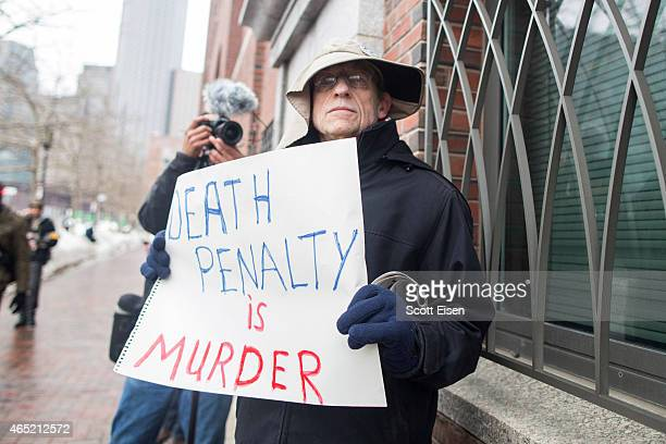 Joe Kebartas of South Boston protests the death penalty outside of the entrance to the John Joseph Moakley United States Courthouse during the first...