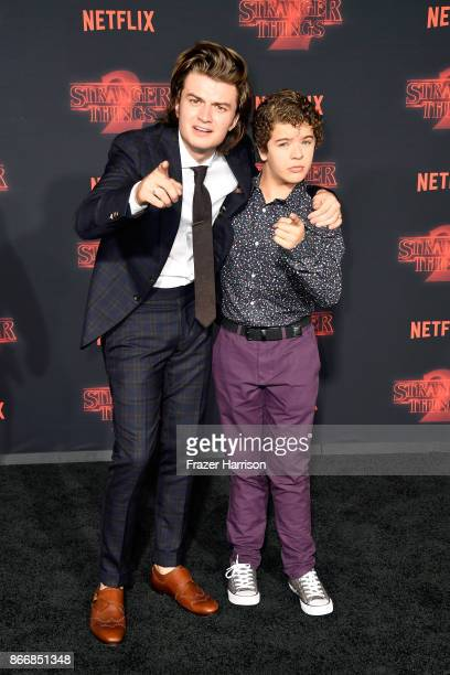Joe Keery and Gaten Matarazzo attend the premiere of Netflix's 'Stranger Things' Season 2 at Regency Bruin Theatre on October 26 2017 in Los Angeles...