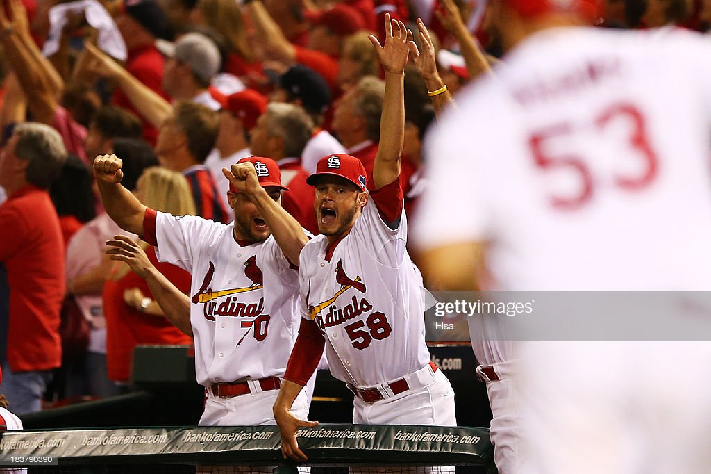 Joe Kelly #58 celebrates as Matt Adams #53 of the St. Louis Cardinals rounds the bases after hitting a two-run home run in the eighth inning against the Pittsburgh Pirates during Game Five of the National League Division Series at Busch Stadium on October 9, 2013 in St Louis, Missouri.